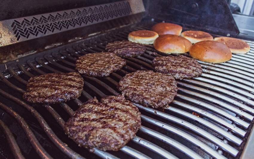 Wagyu burgers from the recipe cooking on the grill