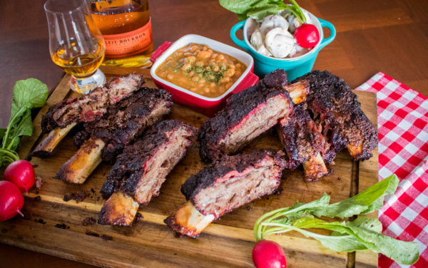 Image of a platter of slpw smoked barbecue Wagyu beef ribs